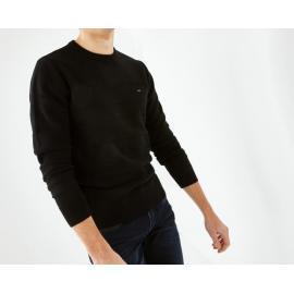 Pull noir en coton à rayures texturées.