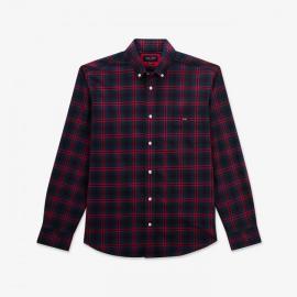 Chemise bleu marine en coton à carreaux rouges.